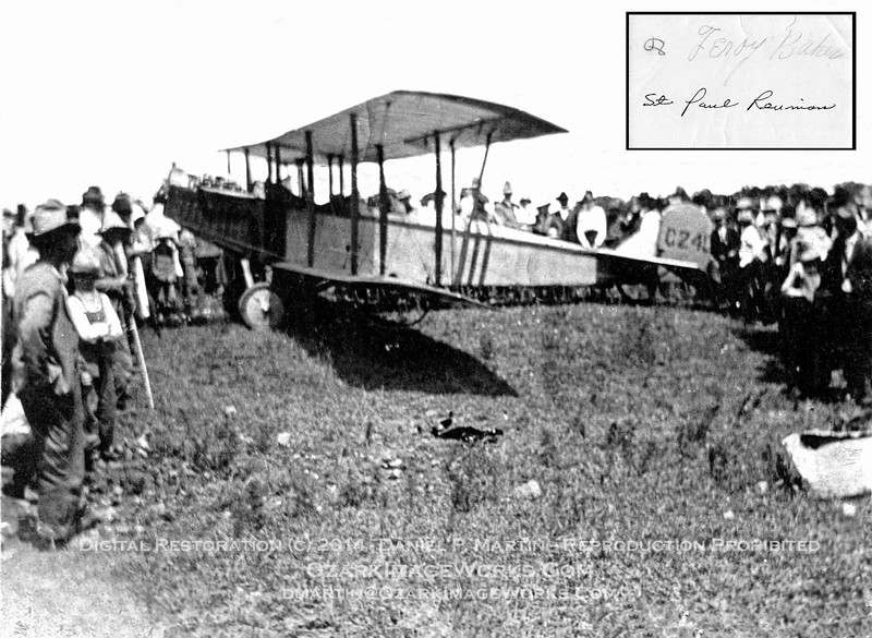 "As the story was handed down to me:  First aircraft to land in Madison County, AR, at the St. Paul Reunion (predecessor of the ""Pioneer Day"" gathering in St. Paul).  The original photo is a badly deteriorated 2.5"" x 3.5"" B&W print; upper right inset is the hand-written inscription on the back of the print -- my maternal grandfather's pencil signature in grade school-boy cursive, and a later ink addition ""St. Paul Reunion"".<br /> <br /> Leroy was born in 1905, and the original print shows wear and tear consistent with the print surviving time as part of a young boy's treasure collection.<br /> <br /> I'm not an aviation expert of any sort, but am willing to hazard a guess that this is a Curtiss model JN-4 (""Jenny"") bi-plane.  Correction from more well-qualified folks would be welcome.  The original photo is undated; after the end of WW-I, the JN-4 was popular with ""barnstorming"" pilots.<br /> <br /> The ""Jenny"" was built primarily as a training aircraft for deployment during WW-I.  Tons more information available here:  <a href=""http://en.wikipedia.org/wiki/Curtiss_JN-4"">http://en.wikipedia.org/wiki/Curtiss_JN-4</a><br /> <br /> In the high-resolution scan, the tail number appears to be C245.  If that's correct, some time after it's detour through St. Paul Arkansas, this machine later wound up in Canada and met the fate of many other training aircraft:  <a href=""http://flyingmachines.ru/Images7/Crowood/109-3.jpg"">http://flyingmachines.ru/Images7/Crowood/109-3.jpg</a><br /> <br /> The Encyclopedia of Arkansas History and Culture mentions several early aviation events in the NW Arkansas region during the 1910's, though not this particular appearance in SE Madison County.   Article available here:  <a href=""http://www.encyclopediaofarkansas.net/encyclopedia/entry-detail.aspx?entryid=4589"">http://www.encyclopediaofarkansas.net/encyclopedia/entry-detail.aspx?entryid=4589</a>"
