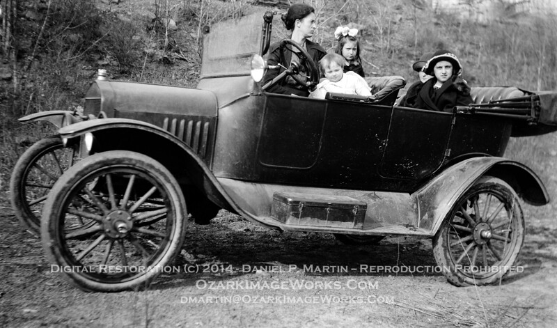 """1 Mile West of Pettigrew""<br /> <br /> My great-grandparent's 1920 Ford Model T Touring Car. L-to-R: My great-grandmother Helen (Mooney) Barker, unidentified child, and daughters Elva, Gladys and Gail. Hand-written caption on the original negative reads ""1 Mile West of Pettigrew"".<br /> <br /> Digital image restored from original negative."