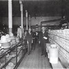 Mr. J. H. Wicecarver at left with store interior and drummer (Salesman) also Tom Barks and Mrs. Heerman