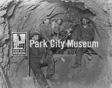 Miners working with a Burleigh Drill at the 900' Level, Daly West Mine, ca.1900 (Image: digi-3-164, Jordanelle Special Service District Digital Collection)