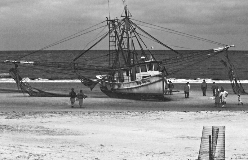 Shrimp boat Miss Shirley grounded on Jekyll Beach 2004. Later she burned to the waterline on St. Andrews Beach. Photo designed to be timeless.