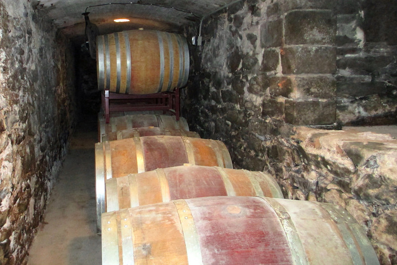 A long underground tunnel leads into the winery, passing numerous side-halls displaying various aspects of the winery process...