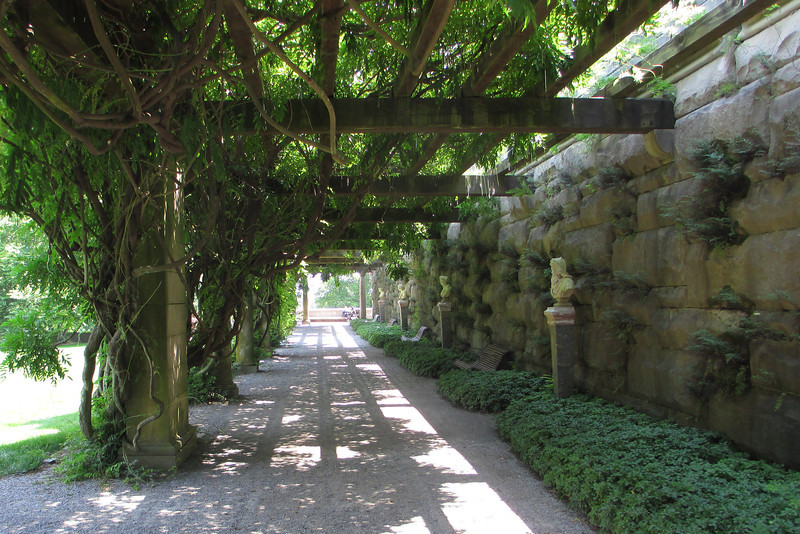A vine-covered breezeway provides some welcome shade as we walk down to the Walled Garden...