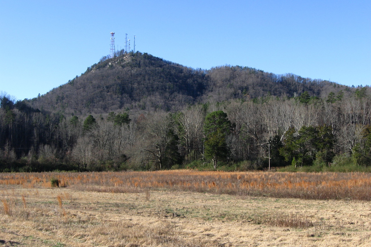 """<b>Currahee Mountain</b> as viewed on my approach from the east.  The name <i>Currahee</i> is a Cherokee word meaning 'stand alone'.  This is appropriate as the peak sits rather conspicuously detached from the neighboring ridges to the north.  During the war the paratroop trainees adopted the mountains name as their motto, along with the phrase <i>""""3 Miles Up, 3 Miles Down""""</i> in reference to the training runs they were required to do on it slopes.  I was quite excited to have this opportunity to walk in their footsteps..."""