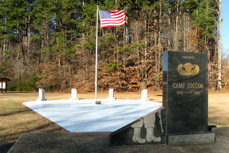 Before heading up the mountain I stopped to pay my respects at the Camp Toccoa Airborne memorial which is just a short distance up the road from the trailhead.  The simple memorial was dedicated by the remaining survivors of the camp in 1990.  The simple marble monument in front details the cost each regiment paid in the war while the memorial walk beyond, in the shape of a deployed parachute, contains monuments to each individual regiment...