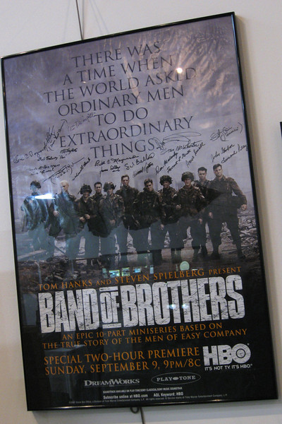 One of the first displays you pass is a 'Band of Brothers' movie poster.  The signatures were added by the veterans, above the actors who portray them in the film...