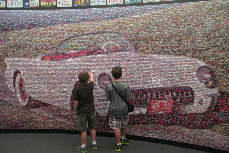The boys take a look at the 1953 Corvette picture collage...