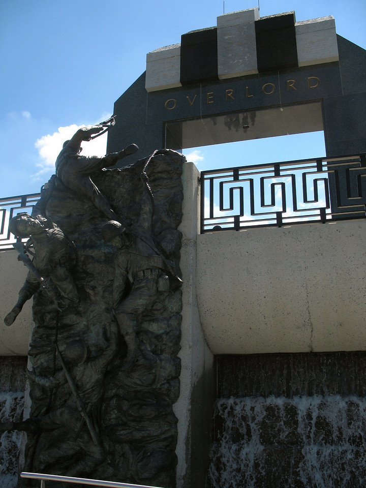 "Landing Memorial - ""Scaling the Wall"" - These figures represent the teamwork of the U.S. Rangers as they stormed the cliffs of Pointe du Hoc."