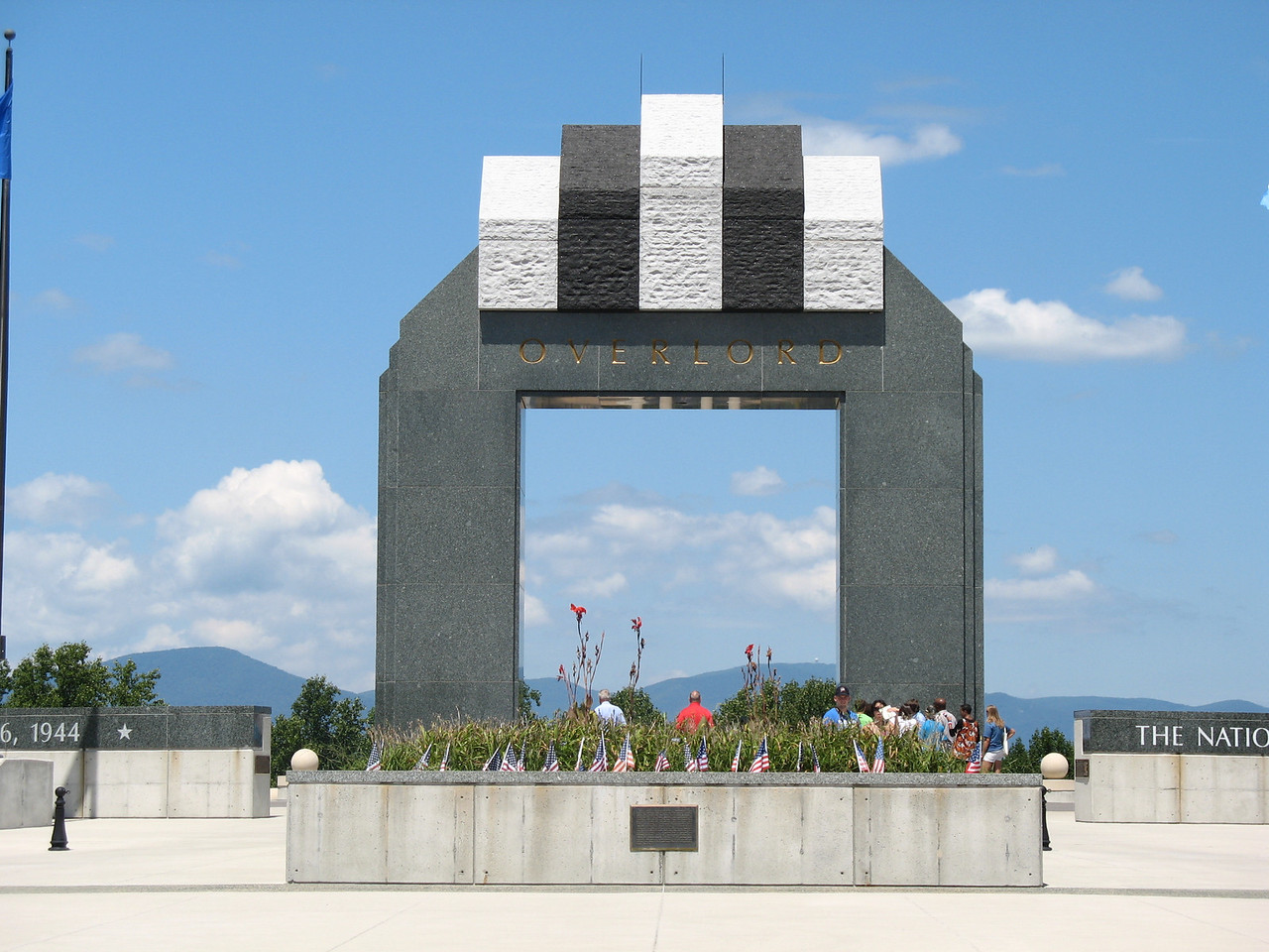 Victory Arch - This monument is 44 and 1/2 feet high and stands above Victory Plaza. The colors on the upper part of the monument symbolize the markings of Allied aircraft during the invasion.