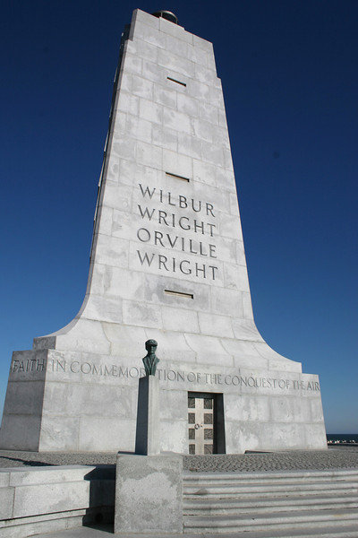 "The north face of the monument...the inscription reads, <i>""In Commemoration of the conquest of the air by the brothers Wilbur and Orville Wright. Conceived by genius. Achieved by dauntless resolution and unconquerable faith.""</i>"