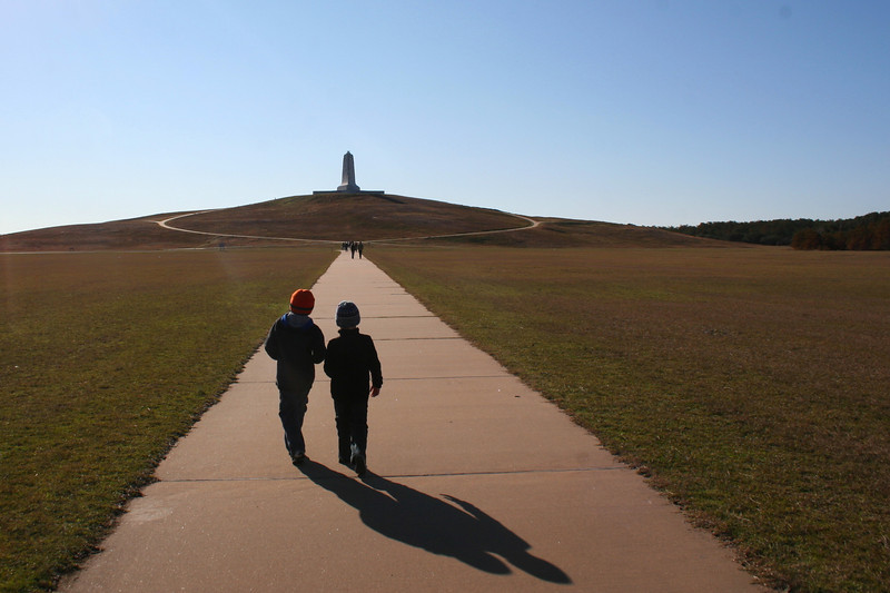 My two boys lead the way down the half mile path to the monument...back in 1903 this was all open sand, I assume that the grass was planted to preserve the dunes...