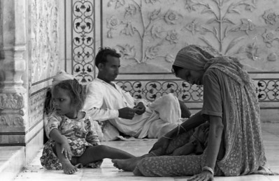 Family resting on the cool marble floors.