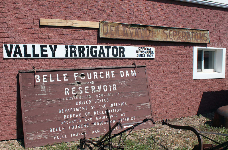 Signage from both the old Newell newspaper -- the <i>Valley Irrigator</i> -- and the Belle Fourche Dam and Reservoir are exhibited just outside the Newell Museum.