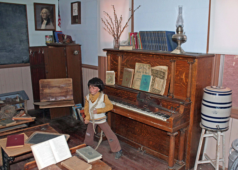 Many one-room schools provided music as an important part of the educational experience.  Sometimes an organ was in the schoolhouse.  This school had a piano.