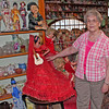 Several hundred dolls are on display in the upstairs gallery of the Newell Museum.  Curator Linda Velder shows us one of them.