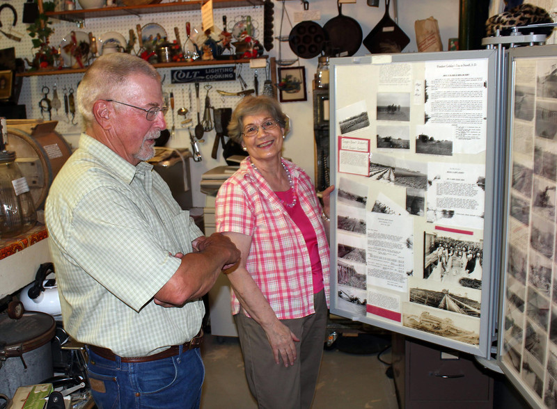 Don Matthesen of Spearfish and museum curator Linda Velder look through the many display boards at the Newell Museum.