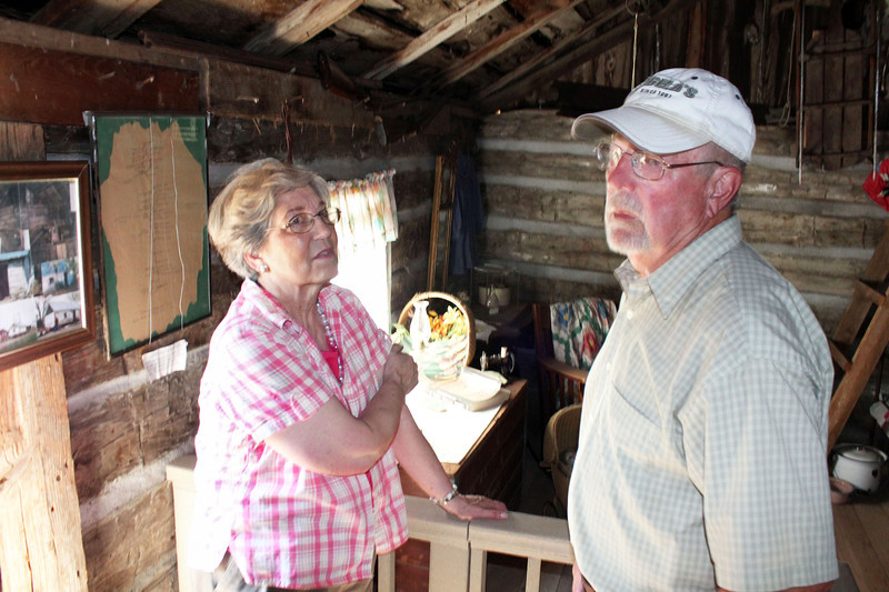 Linda Velder and Don Matthesen inside the Flaigg Homestead Cabin.