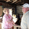 Linda Velder and Don Matthesen inside the Flaigg Homestead Cabin.