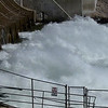 Jackson Lake dam spillway in the spring - - Snake River
