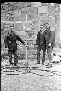 The steeple jacks proudly display their accomplishment