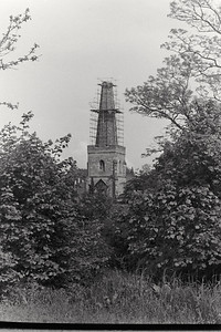 A view of the spire under repair from our garden at the post office. I always remember how loud and clear the guys working on the spire could be heard as they talked and commented on work and the scenes below, particularly comments on any young ladies seen walking down the street.