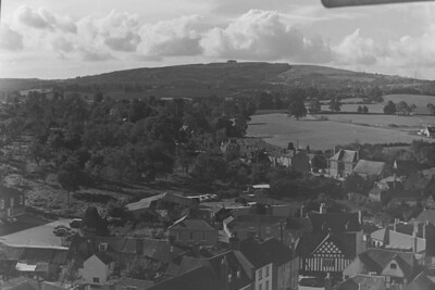 May Hill in the background and the Market place bottom with Culver St. in the center. Center was Freemans Orchard where now stands Budgens Supermarket and multiple new houses.
