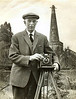Robert H Bisco with his trusty Sanderson 1/2 plate Camera.<br /> In the background is Newent St Mary's Church with work being done on the spire 1971/72.