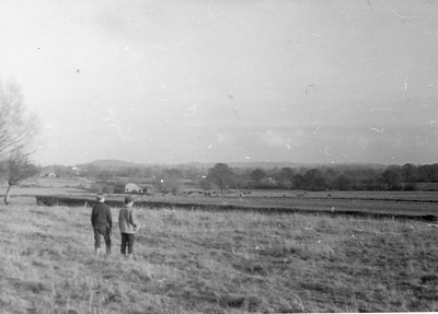 Neil Bisco & Mike Philips (Smiley) look down across the Fields to Freemans farm buildings, sadly now all a huge housing estate.