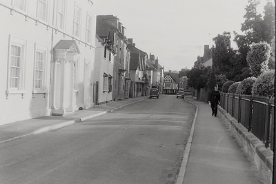 Doctor Tomlinsons home Porch House first on the left as a local Bobby walks the beat on the right alongside St Marys Churchyard.