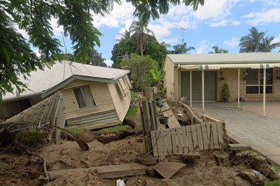Some houses were comprehensively trashed by the flood, while others adjacent were untouched. Possibly the concrete paving did not allow the floodwaters any small piece of access to start the erosion process.