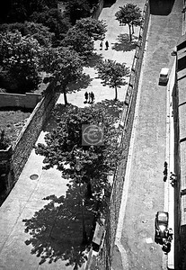 Looking down on the wall from the top of the pillar, but I can't make sense of the view, not unless there were some big changes before the Google streetview car came along. Maybe a trip on Ryanair is called for.  Ok, mystery solved - the street is Nailors' Row,  the houses were demolished about 10 years after this photo, and the street is now a grassy bank. Thanks to JPC for the information.