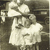 11. At the Davis place, Grandma holding Donna Maye, with Betty and Harry, Jr. In back is Maxine walking with Donald Chestnut. about 1933-34