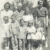 7. From back left, Betty, Grandma Barrett, Darlene Bonham, Lorene. in front from left, Janet, John Clinton, Russell, Eloise and Becky. about 1946