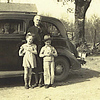 9. At the old Davis place about 1936, Maxine in the car, and Grandma with Betty and Lee, Jr.