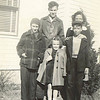 2. From left, Lee, Jr., ?, Betty behind Bill, and Janet in front. about 1944