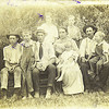 5. This photo was taken about 1917, and all but Raymond are present. From left, Frank, Othel, Jess, Betty holding Bythel, Jim holding Paul, and in back are Beulah and John.  In all, Betty and Jim had eight kids; the younger six were Beulah (b. 1902 and married a Piper), John Andrew (b. 1905 and married a Turner, then a Malone), Othel (b. 1908 and married a Smith, then an Eagan), Paul (b. 1912 and married a Foster, then a Whiteside), Bythel (b. 1915 who married a Sullivan), and Raymond (b. 1920 and married a Ballard then a Hermihouse). Like many families during those years, most of the kids were tagged with nicknames: Jesse was Jess, Frank was 'brother', Beulah was 'sister', John Andrew was 'sonny', Othel was 'doak', Paul was 'sug', Raymond was 'snooky', and Bythel was just 'B.R.'