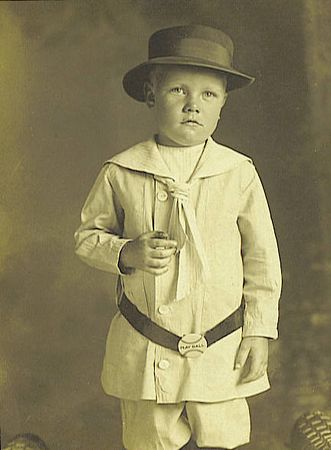 1. This is one of the best photographs in our entire collection of Barrett pictures. Little Bus Barrett, born William James Barrett on Jaunary 24, 1909, is displaying his mashed thumb for all future generations to see.