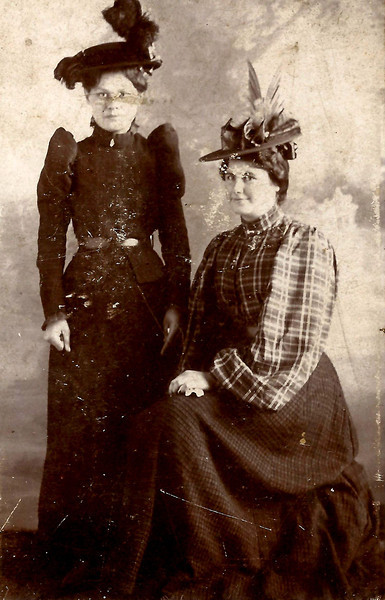 1. Liza, seated, with a cousin, Betty Allen.  Betty's father was Tom Allen, who was married to Liza's Aunt Mary Baldwin Allen. The Allen kids and Barrett kids were kin to each other on both their mother's side and their father's side.