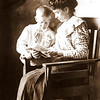 9. A beautiful photo of Mary and Raymond, who was born on Feb 10, 1903, and died on Sept 22, 1957.  This may have been taken about 1910.<br /> <br /> Mary and Andy Sanders' children were: 1. Roscoe (died as an infant, between their marriage in 1896 and the 1900 census); 2. Carless Mae (2-22-1898 to 7-  -1980);    3. Raymond R. (2-10-1903 to 9-22-1957);    4. William Faye (4-19-1906 to 10-22-1918).