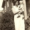28. Irene with Maxine's son, Donald Chestnut, about 1934, in front of the porch at the St Louis Street house. She's wearing a ring so she may have still been married to Dewey Stringer.