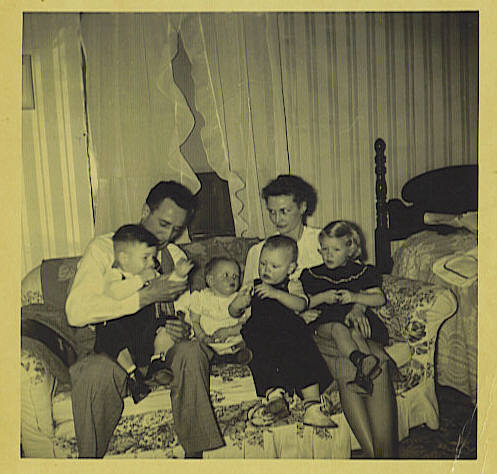 1. This series was probably taken about summer of 1948 at Granny Pyron's house on 19th in Humboldt. Pony is holding David Allen Rushing, then Sandra Kemp (b. Dec. 1947), then Mary holding Ronnie and Sylvia.