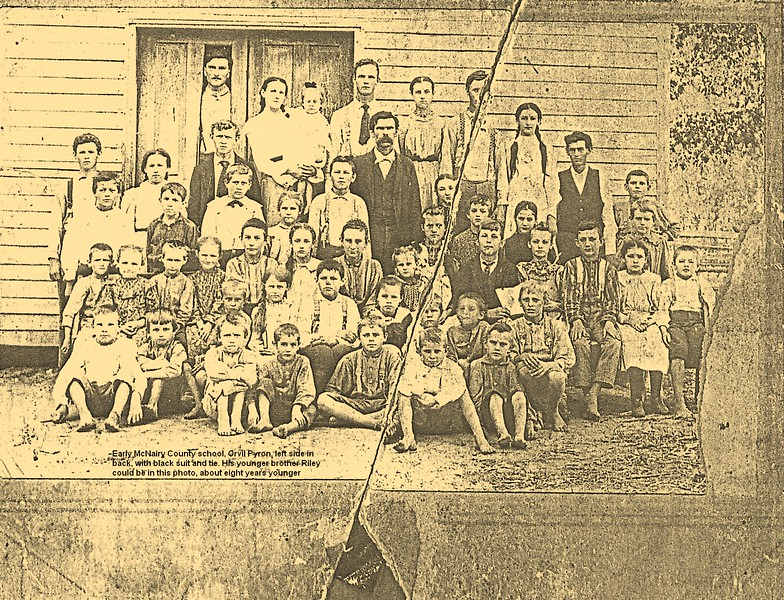 1.  I will use this gallery to present everything I have on my first cousin, twice removed, Orvil Perry Pyron. He was born October 10, 1878 while the family was living in Clay County, Arkansas. They moved back to McNairy County, Tennessee when he was about three years old. I'm not sure where he got his first name, Orvil, but he probably got his middle name from his mother's side of the family; her father was Allen Perry Swain.  <br /> <br /> This is probably the earlies photograph we have of Orvil. He is in the dark suit in the back, left part of the group. He appears to be about 14 or 15 years old. I think he remained in school longer than many boys his age, because his father, William Henry Pyron (1846-1909) valued education.  At least two of Orvil's sister, Mary and one other, taught school. His younger brother Riley, born in 1886, might well be in this picture, as well as one or two of his sisters. His sister Lula was born in 1881 and Sallie was born in 1889. I think this picture might date to about 1893 or '94. The school could have been Hardins Beauty, or perhaps one near Leapwood.