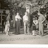 13. The drive used to pass immediately in front of the visitor center. This is the 1956 trip. That's my mom at left with the camera;  perhaps Geraldine Nelson in the dark dress behind her, probably taking a picture of the front entrance; James Raines looking at the photographer; my dad Pony Pyron looking away; and Brady Nelson attends the girls - his younger daughter Nancy seems to be checking out a ring, and my sister Sylvia in the background.