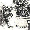 2. Sarah Elizabeth 'Sabet' Swain Pyron in her black bonnet stands at the historic gate entrance to the national cemetery. At right is her daughter Celie Jane Pyron Copeland. This photo, along with several here, dates to the summer of 1917.