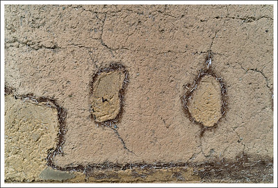 I am not sure if this occurred naturally or if someone created this, but I like the contemplative face worked into the mud wall of the warehouse.