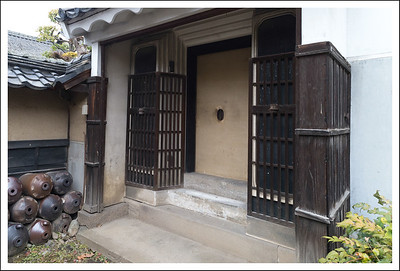Bottles lined up by the door of this store house.  Seishi thought they might be for vinegar which was probably also produced at the sake factory.