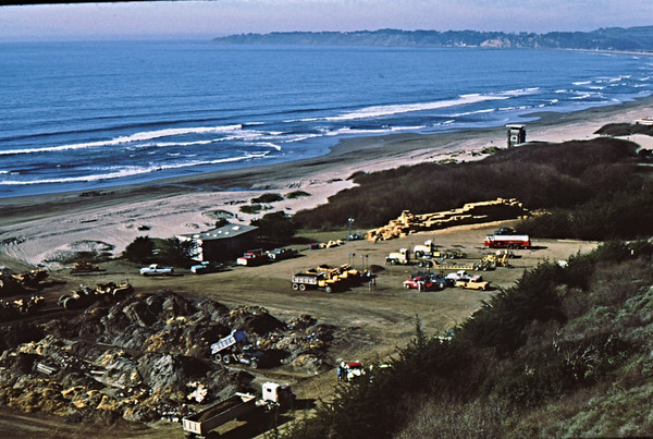 4*Mon, Jan 18, 1971<br /> People: <br /> Subject: trucks, sand piles<br /> Place: Stinson Beach, Marin Co<br /> Activity: clean up oil spill<br /> Comments: the town of Bolinas in background, Bolinas Lagoon on right