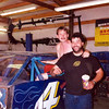 Here I'm with Sean Fitzgerald (the big guy) and his Greg Biffle pavement car that they were trying to run on dirt. I spent one day working on the brakes and chassis and talking to Sean about slowing down to go faster. That night we won two races and were on our way to a third win when Sean blew a hydraulic line. I crew chiefed for Sean several years and once hit him on the elbow with a large wrench because he wasn't listening, he always paid attention after that.