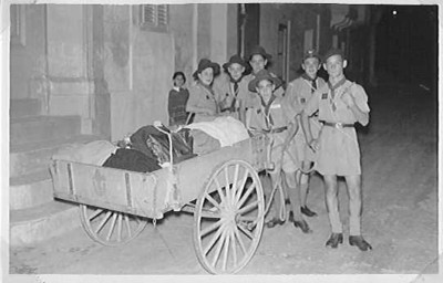 Boy Scouts from 1st Sliema (Bernard's Own) Scout Group in Malta collecting clothes and blankets for the Hungarian Crisis in November 1956.