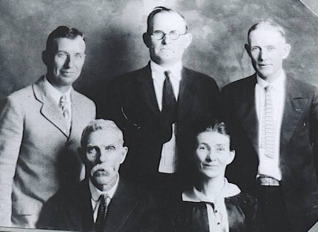 Levi Cutshall (1849-1905) and  Nancy Adelene Sluder (1853-1920) with their sons. Samuel Eliga (1873-1941) is in the middle. That's probably Daniel Monroe (1882-1946) at right and Herman Everette (1890-1948) at left.